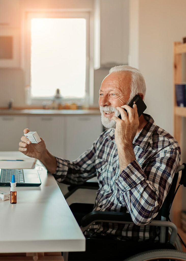 elderly man speaking to remote patient care company